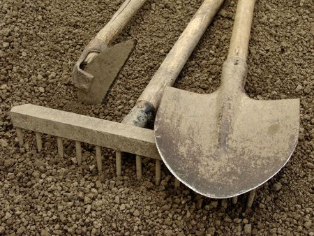 mattock: gardening tools on the ploughed ground