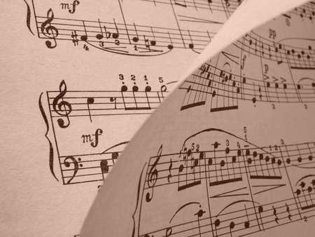 sepia toned old musical notes background Mozart sonatina fragment                                photo