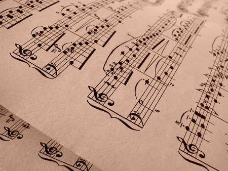 musicality: sepia toned old musical notes background Mozart sonatina fragment