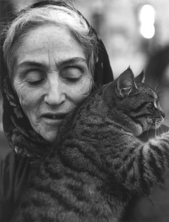 Ashghabat, Turkmenistan - November 13, 1998:  old Chechen woman with her cat.  This woman was among those have been expatriated from Chechnya in the middle of 20th century.
