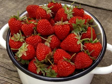 strawberies: saucepan full of fresh cropped strawberies