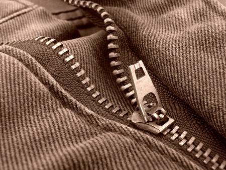 hem: sepia toned denim fragment with zipper