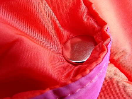 vibrant clothes fragment with metal button
