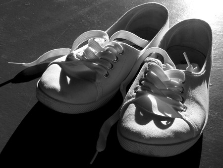 shoestrings: tennis shoes in black and white Stock Photo