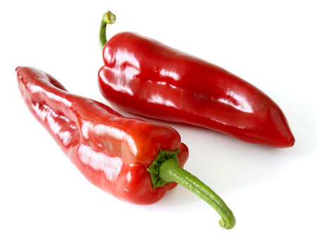 sweet peppers: two red sweet peppers on white