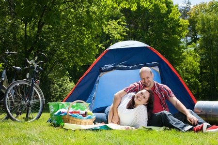 bivouac: backpack, bicycle, bike, bikes, bivouac, blank, camping, Caucasian, Cheerful, couple, encamp, eye contact, family, friendly, friendship, fun, happiness, happy, landscape, laughing, lifestyle, love, lovers, married, nature, outdoors, relationship, romance, LANG_EVOIMAGES