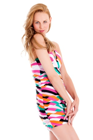 beautifull woman: Beautifull young blond woman in the studio with a colorfull dress