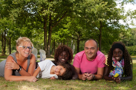 biracial: Happy multicultural family having a nice summer day