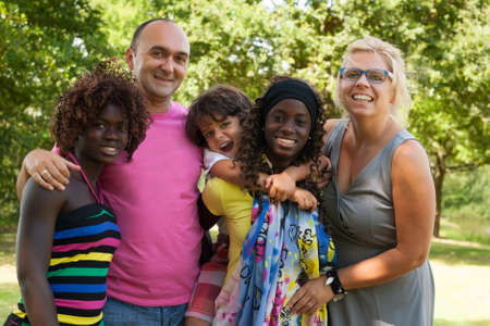 cultural diversity: Happy multicultural family having a nice summer day