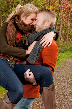 young people fun: Happy young couple is having a nice time in october