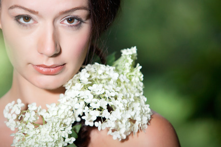 eyecontact: Young beauty woman in the forest whith beautiful looks LANG_EVOIMAGES