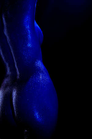 bodyscape: A model with water on her skin