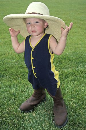 Little Boy in a Big Hat and Boots Stock Photo - 778073