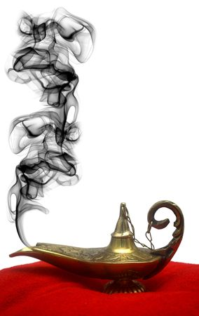 alladdin: A magical genie lamp with smoke on a red velvet pillow.