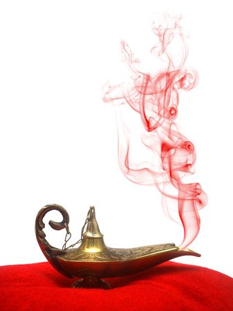 A magical genie lamp with smoke on a red velvet pillow. Stock Photo - 3041526
