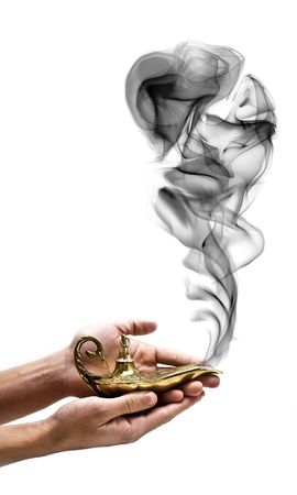 genie lamp: A magic genie lamp on a persons hand, isolated on white. Stock Photo