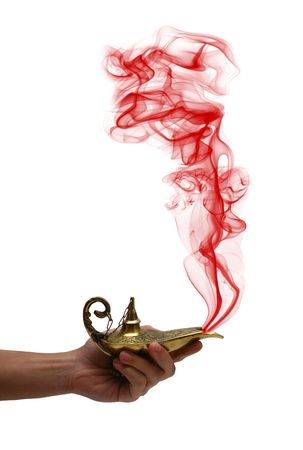 A magic genie lamp on a persons hand, isolated on white. Stock Photo