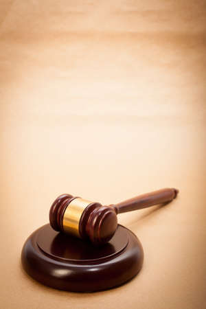 A wooden gavel and soundboard on a light brown background. Stock Photo - 14435192