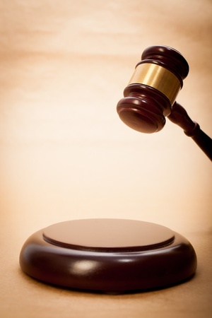 soundboard: A wooden gavel and soundboard on a light brown background. Stock Photo