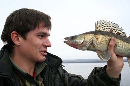 Fisherman and his fish with big toothes Stock Photo - 735846