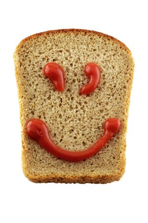Slice of rye-bread with ketchup forming a smiling face