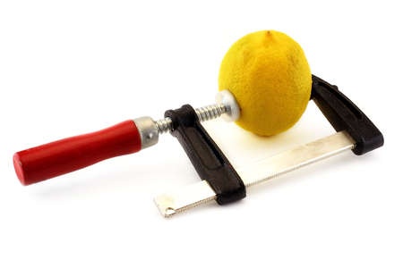 squeezing: Lemon squeezed in a clamp Stock Photo