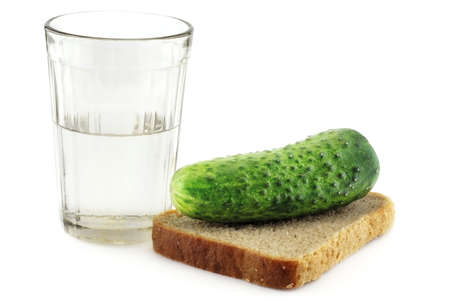 tipple: A glass of vodka with a slightly salted cucumber on a rye-bread slice Stock Photo