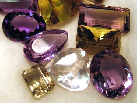 amethyst: Group of faceted gemstones