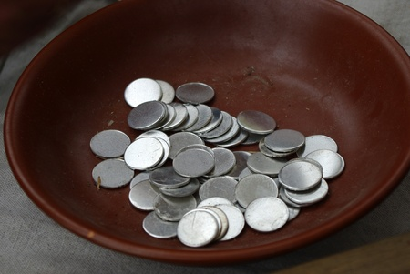 coining: blanks for souvenir coining money in clay cup Stock Photo