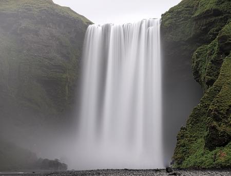 Skogafoss - famous Waterfall near Skogar in Iceland. Beauty in nature. photo