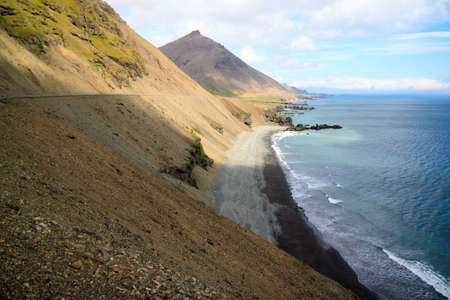 Cloudy sky over the coast in the East Fjords Iceland.