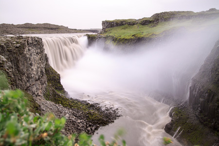 Dettifoss is the most powerful waterfall on Iceland and in the whole Europe  It is located in Jokulsargljufur National Park the northeasten Iceland on the river Jokulsa a Fjollum
