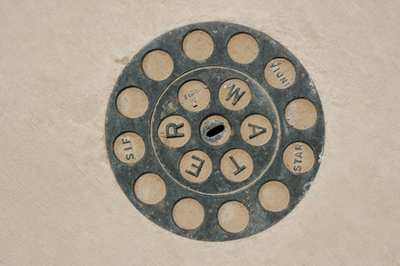 Generic water meter cover cast iron set in concrete Stock Photo