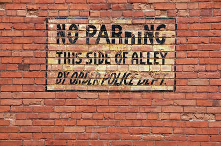 Vintage style painted sign, antique brick wall