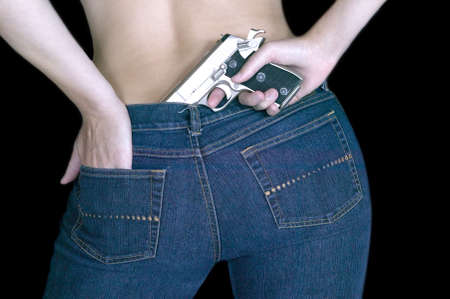 caliber: Woman hiding a gun in the back of her jeans