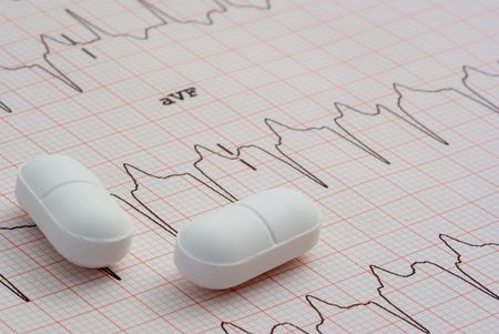 A close up of a EKG with pills sitting on top of it. Stock Photo - 2600573