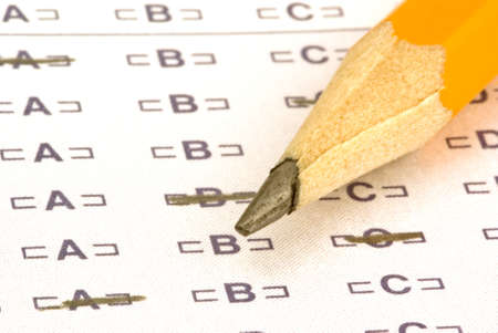 a pencil sitting on a test bubble sheet photo