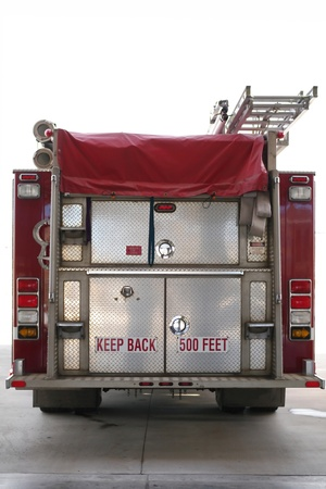The back end of a firetruck with white background isolated photo