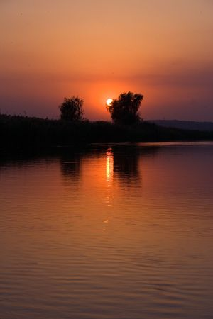 Red hot African sunset on the river photo