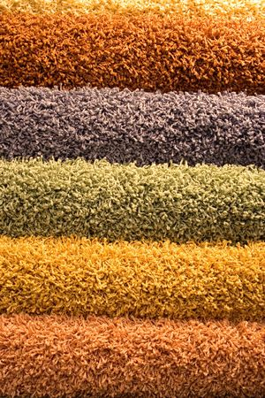 coverings: Multi-coloured fluffy carpets for a background. Multi-coloured floor coverings.