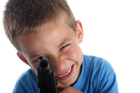 Young boy in bright clothing portrait shot aiming toy gun at camera photo