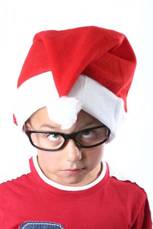 Young boy with santa hat and glasses photo