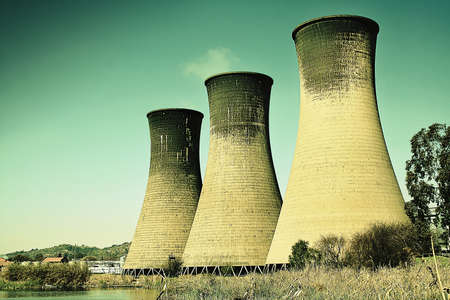 inconvenient: Coal powerstation with grunge look. Global warming concept. Some copyspace. Stock Photo