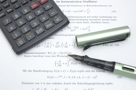 formulae: Still life of a calculator and an open pen on scientific paper