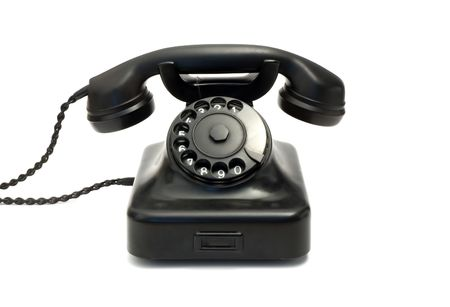 Retro black telephone isolated on white photo
