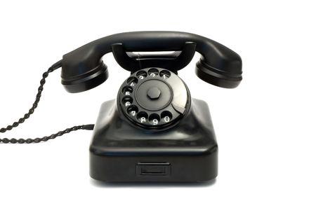 Retro black telephone isolated on white photo