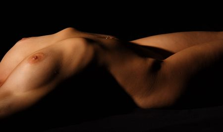 Stretched low-key nude woman body