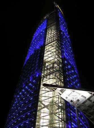 Blue illuminated business building
