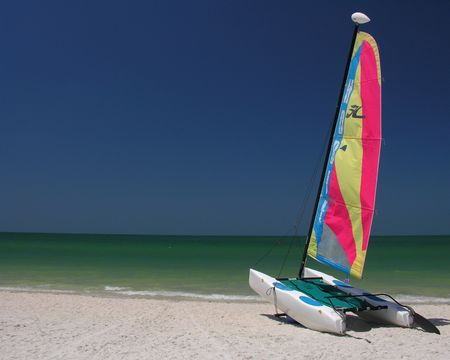 catamaran: A colorful catamaran on the beach waiting for wind...