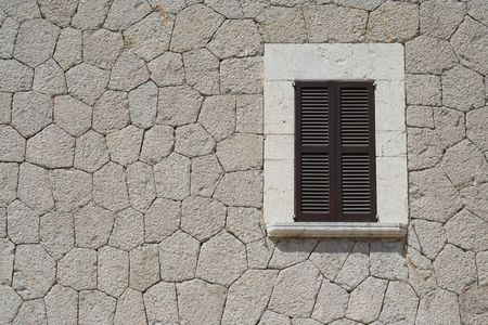 historically: A historical wall with a window on the spanish island Mallorca...